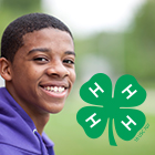 Smiling youth with 4-H symbol