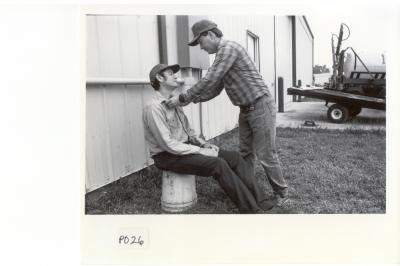 Pesticide poisoning can be easily confused with heat stroke and other illnesses. Here, the victim has been moved to fresh air and is having his collar loosened as part of the first aid procedure.