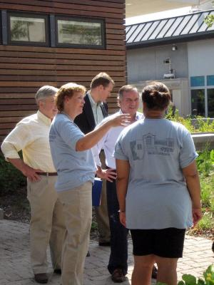 Master Gardeners talking to the Mayor about the sustainable parts of the garden.