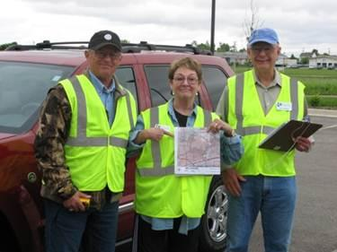 Boone County volunteers with map of ash tree locations.