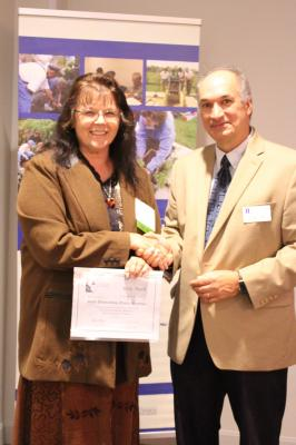 2017 State Outstanding Master Gardener Award winner May Bach with Dr. Czapar