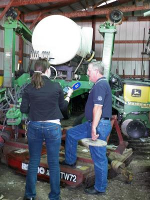Figure. Terry Davis, a farmer and no-till proponent, speaks with a reporter from German Public Radio in his machine shed about no-till agriculture.