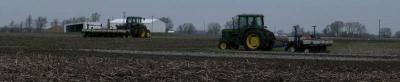 Figure. Marty Johnson and Brian Mansfield plant corn at the NWIARDC on April 21, 2014.