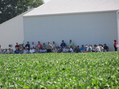 Figure. Attendees find some shade while listening to Dr. Emerson Nafziger talk about getting high soybean yields at the NWIARDC 2012 Field Day.