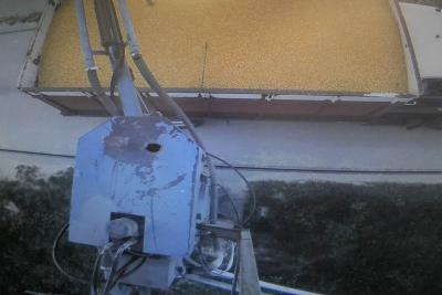 Figure. A camera located above a sampling probe helps workers in the scale house at a grain elevator in Western Illinois collect samples.