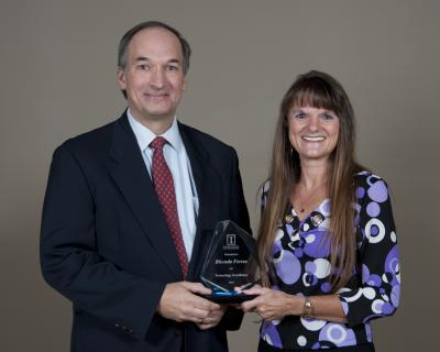 Dr. George F. Czapar, Associate Dean and Director of Extension presents Rhonda Ferree with the Extension Technology Excellence Award