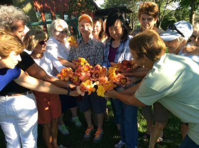 McDonough County Master Gardeners pose with their favorite daylilies.