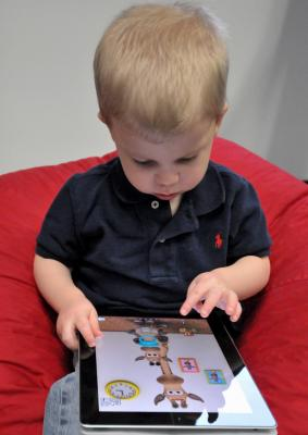 Child with Apple iPad