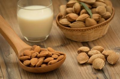 bigstock-Almond-milk-with-almonds-on-a--152127227