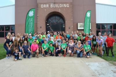 Exhibitors from Sangamon, Menard, and Logan counties gather in front of the Orr Building on the Illinois State Fairgrounds before judging begins at the Illinois State 4-H Show! Our counties had nearly 100 4-Her%u2019s representing at this show as well as the many 4-Her%u2019s participating in the junior livestock shows!